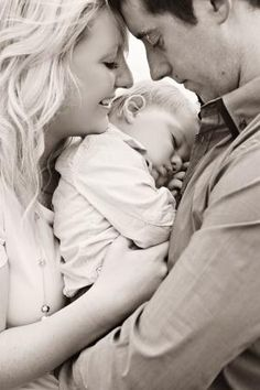 this is a cute family pic! :) Aww, I bet it's their first born child.