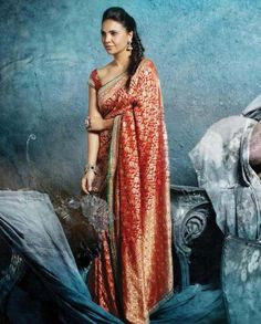#Exclusivelyin, #IndianEthnicWear, #IndianWear, #Fashion, Red Sari with Floral Patterns by Lara Dutta