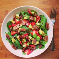 Spinach, strawberries, avocado and candied pecans with a sweet balsamic vinaigrette. Vinaigrette: 1/2 cup olive oil, 1/4 cup balsamic, 2 minced garlic cloves, 2 tbsp sugar, 1/2 tsp salt. Add all to a jar and shake.