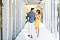 Adorable couple snuggling and walking down a cool industrial hallway on the UCSD campus, engagement photos in La Jolla, Cavin Elizabeth Photography