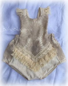•••Bohemian Sunflower••• •••Bohemian Baby Romper, made with a premium linen blend and bohemian embroidered, sunflower print. •••Fun Fringe lines the front and shoulders/back. •••Perfect for photo shoots and special occasions. •••The back is elastic. Ties on back with creamy linen