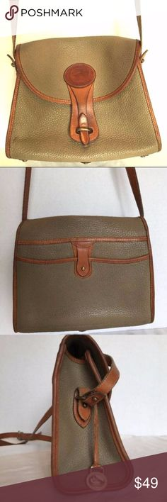 "DOONEY & BOURKE Classic Crossbody Bag Essex Flap Title DOONEY & BOURKE Classic Crossbody Bag Essex Flap All Weather Leather Brand Dooney & Bourke Style Crossbody Bag Size 10.5"" Length, 9"" height, 3.5"" width, 20"" strap drop Color Tan trim, green khaki Material leather Features 1 main compartment, 2 open pockets, 1 zip pocket Condition pre-owned. Outside lite pen mark front lower left, some scuffing on bottom trim, leather looks good. Inside has a lot of ink marks. (see pics) [PB3] Dooney…"