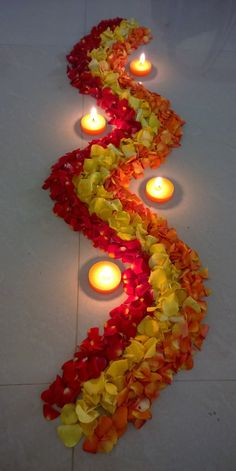 Zigzag shape flower rangoli for festive Diwali . Rangoli Designs Flower, Rangoli Ideas, Rangoli Designs Diwali, Rangoli Designs Images, Flower Rangoli, Rangoli With Flowers, Diwali Flowers, Diwali Party, Diwali Craft