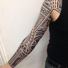 Traditional, tribal, sleeve tattoo on TattooChief.com