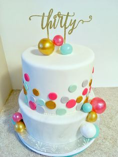 2 tier birthday cake with gelatin bubbles, polka dots, edible glitter and grey marble.