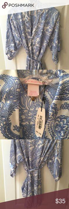 Beautiful NWT Victoria's Secret satin kimono Beautiful light blue and white paisley design on a satin kimono. Has an inner tie to help keep it secure. Victoria's Secret Intimates & Sleepwear Robes