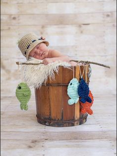 Gone Fishing!! This adorable fisherman set is perfect for a photo shoot or makes an awesome baby shower gift! This set includes: A fisherman hat, and four crocheted fish on a yarn string. You can choose the color of your fish and hat to make it a one of a kind item for you. However, if