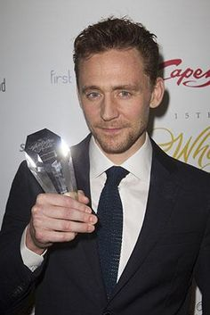 Holding the winning trophy 'Coriolanus' as the Best Revival Play at the WhatsOnStage Awards at the Prince of Wales Theatre in London, 15 Feb 2015