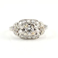 Estate 0.98 carat total weight diamond ring. This 14 karat white gold ring has a 0.25 carat center round brilliant diamond VS2 clarity H color and 16 round