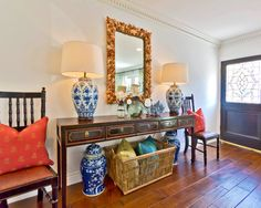 touches of chinoiserie in the blue and white jars and lamps.