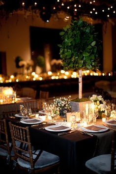 Intimate candle lit wedding reception dinner
