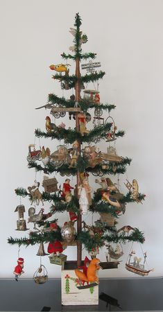 DRESDEN TREE: Beautiful Dresden Ornaments on a feather tree. Dresden ornaments are made from cardboard.