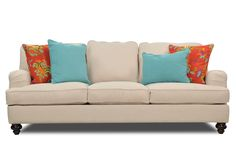 A sensational splash of color breathes new life into the Carmel sofa's timeless frame. Presented in bright turquoise and flamboyant floral fabrics, the accent pillows bring vibrant energy to traditional English roll arms and turned legs. Shop online now. #LivingSpaces
