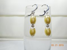 Yellow dangle earrings  Pale yellow and silver earrings  Yellow oval bead earrings  Dressy dangle earrings by leaujewls on Etsy