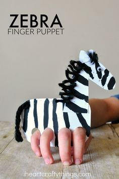 This finger puppet zebra craft is fun for kids to make and kids will love playing with their zebra craft by making it gallop around the house. Cute animal craft, zoo craft for kids, preschool craft, crafts for kids and summer kids craft.
