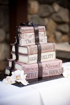 A glossary program, library book ring holder, author table names, and a big old stack of books made out of cake — we LOVE book week! This wedding is a double dose of awesome with a ceremony a…
