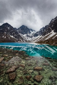 Blaavatnet, a beautiful glacial lake at the foot of the tines in Lenangen, Lyngen, Northern Norway