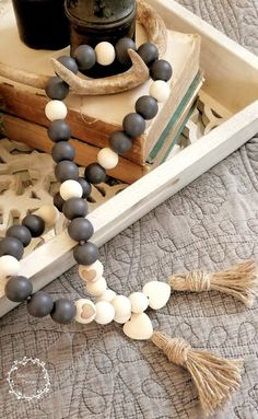 Large wood bead garlands also spotted at market for You can make these yourself for a DIY project or purchase online. Wood Bead Garland, Tassel Garland, Christmas Bead Garland, Christmas Crafts, Rag Garland, Garland Ideas, Christmas 2019, Hobbies And Crafts, Diy And Crafts