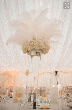 At the back of the sanctuary, behind the first chairs of the aisle. OR Centerpiece for bride and groom table and cake table