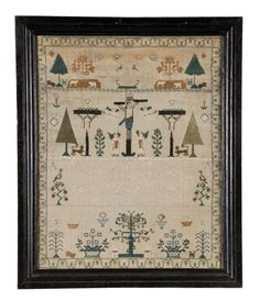 A needlework sampler, by Ann Childs, early 19th century, designed with Christ on the Cross between the two thieves, the upper section with animals, birds and trees, the lower portion with a prayer, flowering plants and Adam and Eve in mainly cross stitch with green, cream and brown silks on a wool ground. 43cm x 33cm, English, circa 1820, framed and glazed. Provenance: Widgenton House, Buckinghamshire