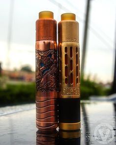 Which Purge Mods setup do you like best... Left or Right? _______________________ On The Left We Have: ️ATTY- PRG-25 RDA ️MOD- Hagermann Serenity Koi All Copper Everything! _______________________ On The Right We Have: ️ATTY- PRG-25 ️MOD- Silencer Mech Mod All Brass Everything!