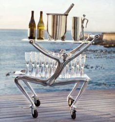 Bar Cart, Water Jug, Champagne Cooler Champagne Glasses all available from Carrol Boyes