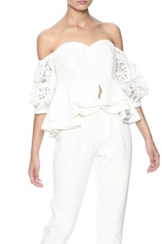 White lace top with a layeredpeplum waist, sweetheart neckline, off the shoulder sheer 3/4 sleeves and a zipper back closure. Lace Layered Peplum Top by Ina. Clothing - Tops - Blouses & Shirts Clothing - Tops - Short Sleeve New York City New York