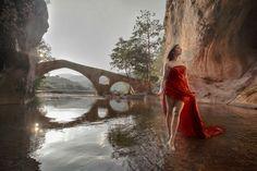 Bridge over calm water - null