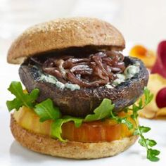 Blue cheese and slow-cooked onions turn a grilled portobello into an indulgent portobello burger for a vegetarian dinner even meat-eaters will love!
