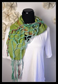 Amber Kane creates cutting-edge style handloomed embellished scarves. Find her at FabricatedEnds.