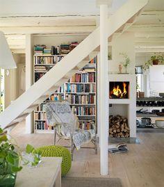 Scandinavian living; totally live that fireplace cum bookcase!