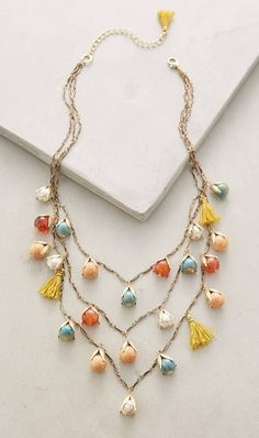 Liking how the tiered necklace looks a little longer. The whimsical mix of tassels and beads in great. And I love the color combo.