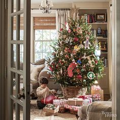 Christmas Decorating Ideas | I love how a basket is used instead of a traditional tree stand and skirt!