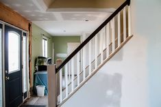 A guide for how to open up an interior staircase will give you a tutorial for how to open up walls. This open floor plan concept was very easy to DIY. Interior Staircase, Wood Staircase, Staircase Remodel, Staircase Makeover, Staircase Design, Interior Walls, Staircase Ideas, Painted Stair Railings, Stairs Balusters
