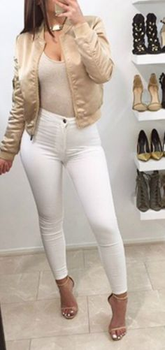 Obsessed over this gold satin women's bomber jacket outfit idea. This is how to wear a bomber jacket with ripped white jeans with heels I love this style