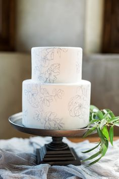 Hand painted wedding cake. Floral design by @mmejerle | Photography by Rustic White Photography Cake by Sweet Caroline's Cakes | Cake Stand by Restoration Hardware.