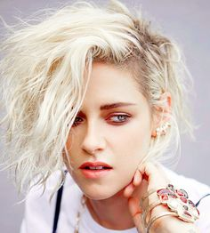 Kristen Stewart pose for Elle China photographer Zack Zhang and styled by Hubert Chen. (September 2016)