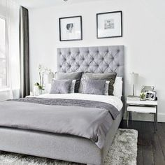 Modern bedroom with grey upholstered bed and soft furnishings