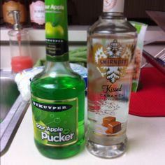 1 oz. Smirnoff Caramel flavored vodka and 1/2 oz. Apple Pucker, Caramel Apple Shots. festive and delicious!