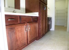 the master bath offers extra counter and storage space for two with double vanities and a full linen cabinet