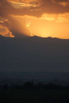 """Rwenzori Mountains -Sunset The 996km2 national park is named after the Rwenzori Mountains which lie 120km along the D.R Congo border, on the west of Kasese and Fort Portal Districts of Uganda. The Legendary, """"Mountains of the Moon"""" are relatively visited and in 1994, UNESCO gezetted the Rwenzoris as an international heritage site. Rwenzori Mountain is the highest mountain range in Africa, and thus provides an unparalleled opportunity to explore East Africa's mountain wilderness."""