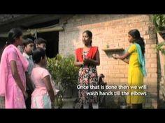 In Kolkata, India, YHC Peer Educators Dipika and Sonia demonstrate proper hand-washing technique.