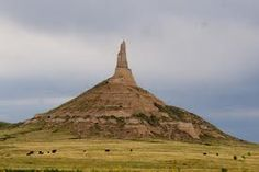 A rock formation in Morrill County in western Neb., Chimney Rock rises nearly 300 feet above the surrounding North Platte River valley. During the middle century it served as a landmark along the Oregon Trail, the California Trail, and the Mormon Trail. Chimney Rock Nebraska, Scottsbluff Nebraska, North Platte Nebraska, Mormon Trail, Into The West, Roadside Attractions, Historical Sites, Natural Wonders, Day Trips