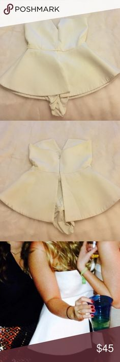 White Strapless Angular Flare Bodysuit - size Sish White Strapless Angular Flare Bodysuit - size Sish - lightly worn, tag cut off but in good condition and very flattering!!! Fits about a size S (32-34 B-C cup) Tops Blouses