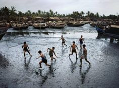 Boys playing football, Sittwe, Burma, photograph by Steve McCurry. Steve Mccurry, National Geographic, Ex Yougoslavie, World Press Photo, Online Travel Agent, War Photography, Street Photography, Landscape Photography, Photographer Portfolio