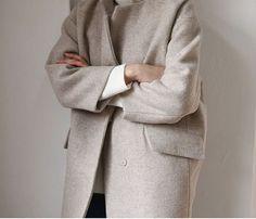 beige coat.