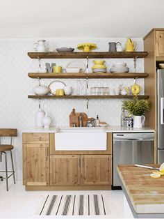 Instead of spending ransom on cabinetry, the design gave Ikea's off-the-shelf pine cupboards a custom look with nickel drawer pulls from Amerock.