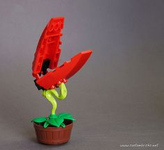 This one comes from customBRICKS and is none other than Audrey II, the man-eating plant from Little Shop of Horrors. One of the best uses of the Ninjago snake I've ever seen. History Of Lego, Doomsday Machine, Legoland California, Lego Man, Little Shop Of Horrors, Building An Empire, All Lego, Lego News, Lego Projects