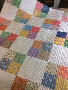 A pretty quilt made for charity. Love the quilt stitching! | Mama Spark's World
