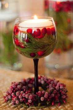 Wine Glass with Cranberries, Pine Twigs, and a Floating Candle